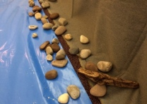 River rocks and drift wood, made smooth by constant washing